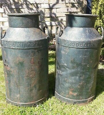 Vintage steel milk churns pair painted green