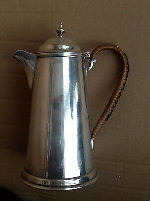 A vintage silver plated hot water pot