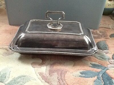 A vintage silver plated entree dish and cover