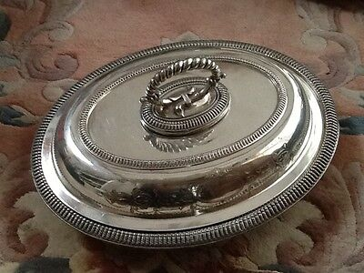 A vintage oval silver plated entree dish
