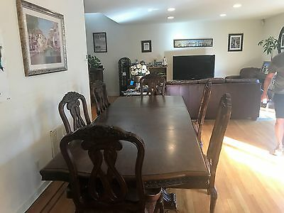 Mahogany wood dining room table with chairs