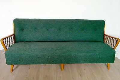 Vintage / Retro mid-century button back sofa with rattan arms.