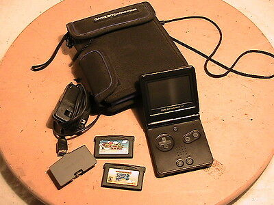 Game Boy Advence with two game cartridges, power supply, case, extra