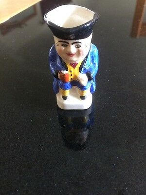 Vintage   mini blue coat Toby jug with pig tail, signed
