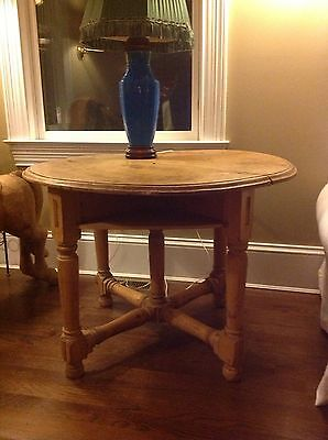 Anitique pine round table with 4 shelves below base