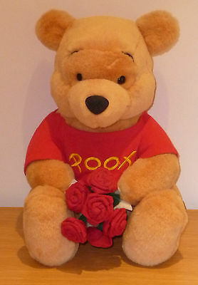 Walt Disney Winnie The Pooh Holding bunch of Red Roses