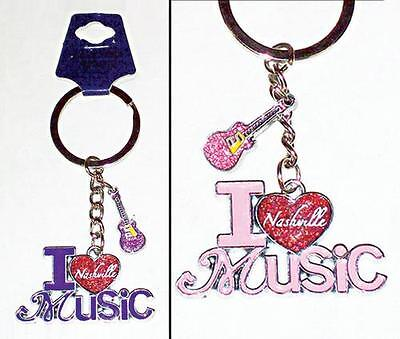 """Two Nashville """"i Love Music"""" Keyrings  With Dangle Guitars  2 Assorted Colors"""