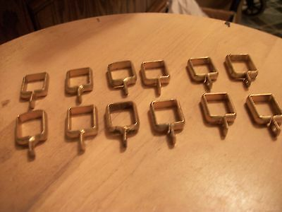 "ANTIQUE-OLD CAST DRAPERY ROD CLIPS LOT BRASS COLOR-12 EACH -1/2"" X 5/8""  ones"