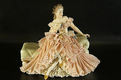 Antique Dresden Porcelain Figurine Woman Sitting on Bench with Fan on Hand.