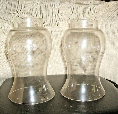 Pair of glass lamp globes decorated with white rose and leaves in the eight inch