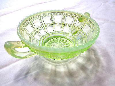 antique green  glass bowl with light creme edge