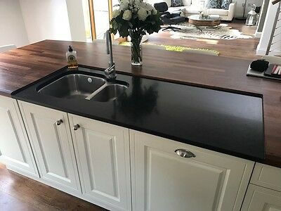 Wood Butcher Block Kitchen and Granite Work Surfaces with Stainless Steel Sink