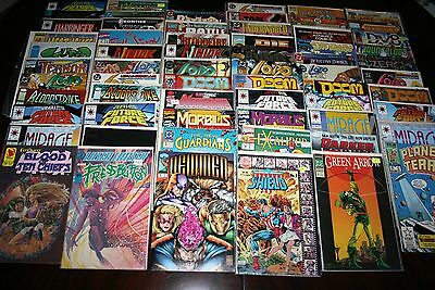 Lot of 65 Marvel, DC, Valiant, Image Mixed Comic Books, most boarded and wrapped