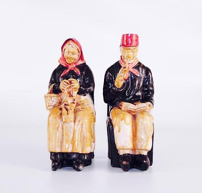 Antique pair of statuettes in plaster grandpa & grandma on a chair