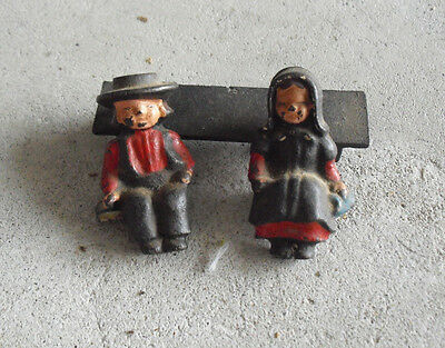"""Vintage Cast Iron Sitting Amish Boy and girl on Bench Figurines 2 1/8"""" Tall"""