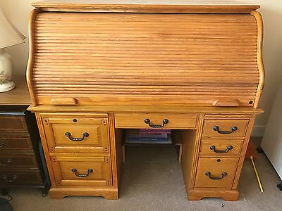 roll top desk (light oak)  immaculate condition.