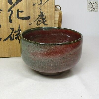 A402: Japanese ONTA pottery tea bowl of good color and glaze with signed box