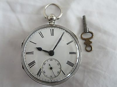 lovely 1870s Sterling silver pocket watch in good working order with key