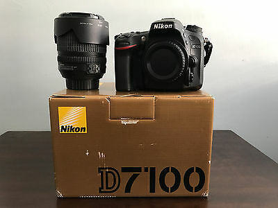 Nikon D7100 24.1 MP DX-Format CMOS Digital SLR Camera W/ 18-105mm Lens + Extras
