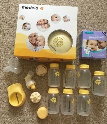 medela electric breast pump with extras