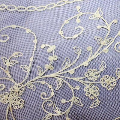 Antique piece of Off-white cotton floral Embroidered Net lace