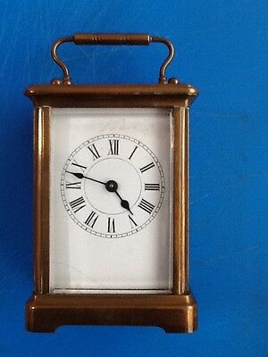 A late 19th Century French brass carriage timepiece