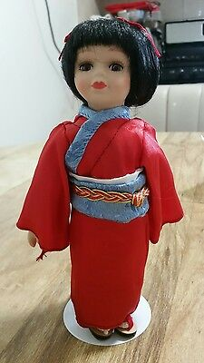 """Petite Porcelain dolls of the world """"Nikko"""" Asian collector's doll"""