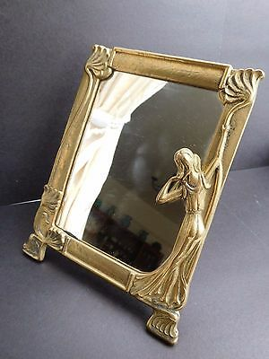 Antique brass table mirror with standing lady to one side Stands 6-1/4 in high
