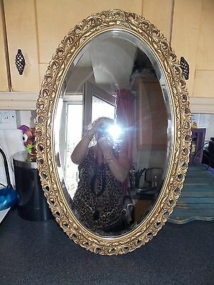 Vintage Mirror oval ornate  gold  frame wood and gesso bevel edge glass  50x77cm
