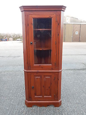 Modern solid pine glazed corner display cabinet wall unit in a honey pine finish