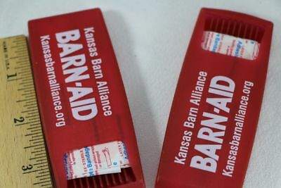 """Lot of 2 Band-aid BANDAGE HOLDER DISPENSERS red plastic """"Barn Aid"""" advertising"""