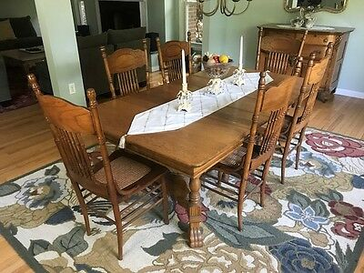 Antique oak dining room table and 6 Larkin oak chairs