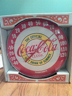 Vintage coke round advertising thermometerer from 1980s. New in box.