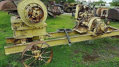 Antique  rock crusher on cart tractor or hit miss engine driven