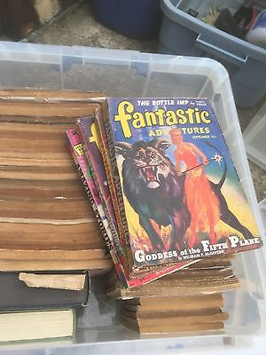 old comics still in plastic sleeves. In good condition