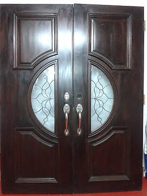 Exterior Front Entry Door, solid hard wood double door with stained glass.