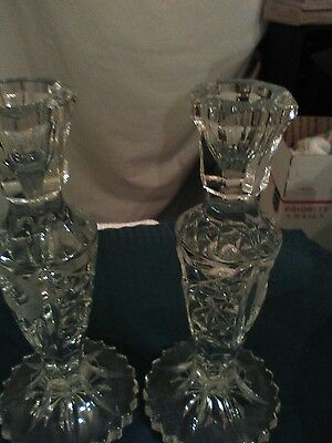 Crystal candlesticks with flowers