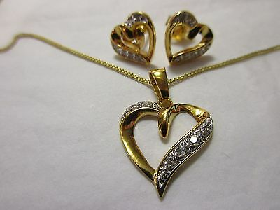 925 silver gilt heart shaped necklace and earrings with clear settings