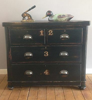 A Victorian ebonised chest of drawers with sign painted type, Haberdashery