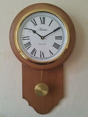Acctim taunton wooden pendulum wall clock with gold effect bezel acctim taunton wooden pendulum wall clock with gold effect bezel gumiabroncs Image collections