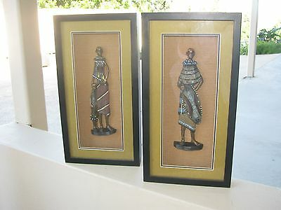 framed figurine of african man with shield and african lady with child
