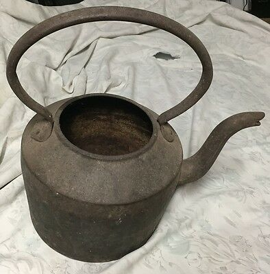 antique cast iron and copper kettle
