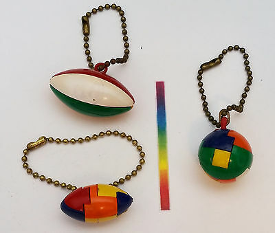 #493 - Vintage Plastic Keychain Puzzle TWO FOOTBALLS and a BEACHBALL