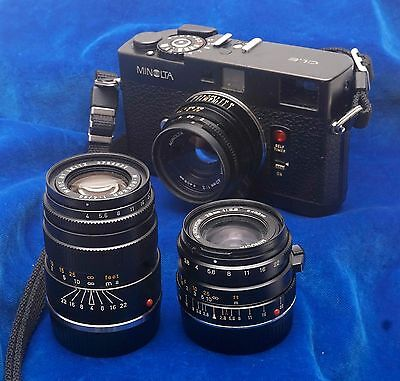 Minolta CLE & 3 lenses, accessories and case. 1980s. Superb camera, works great.