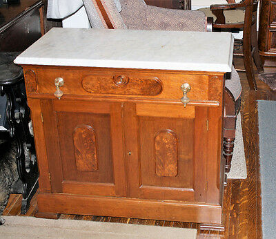 Nice walnut washstand with marble top. Excellent condition inside and out.