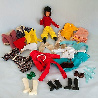VintageArticulated Horse Rider Doll with Riding & Other Outfits