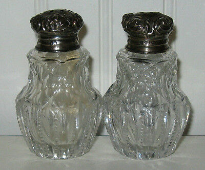 Vintage antique pair of glass salt & pepper shakers with sterling silver lids