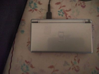 Nintendo ds lite console with super mario and two other games