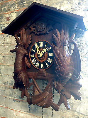 Antique Hunter-style Black Forest cuckoo clock with nice case carvings