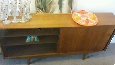 mid century modern sideboard with sliding glass doors, retro iconic 1960s design
